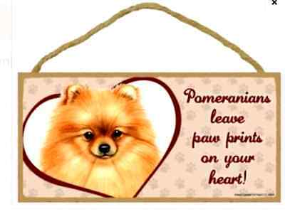 """""""Pomeranians leave paw prints on your heart!"""" 10"""" x 5"""" x 1/4"""" wooden sign"""