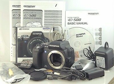 OLYMPUS E-500 E500 Digital SLR DSLR Body only charger, remote, CDs, manuals Card