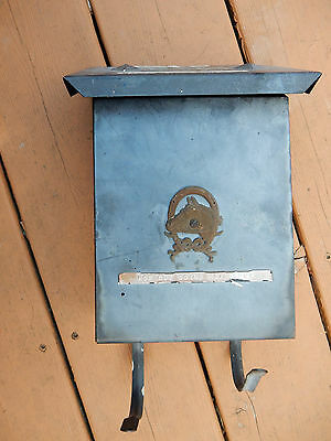 Vintage front porch metal mailbox with horse head emblem