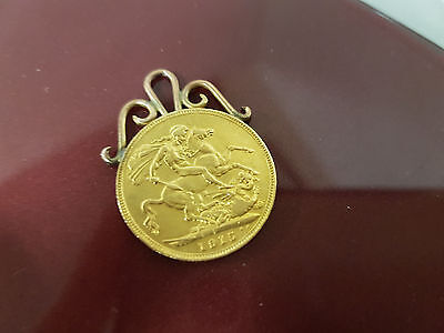 1915 full 22 ct gold sovereign with 9 ct mount