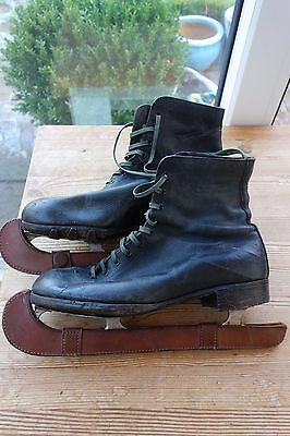 Pair Of Early Leather Booted Ice Skates In Used Condition