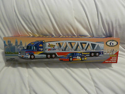 1999 Sunoco Car Carrier with Race Car Collectors Edition NEW