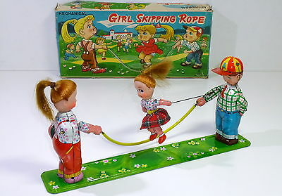 """Vintage Tin # 1950's  T.P.S. (Japan) """"Girl Skipping Rope"""" with Original Box."""