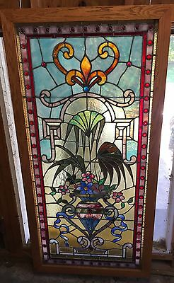 Outstanding stained glass window featuring vase  of flowers