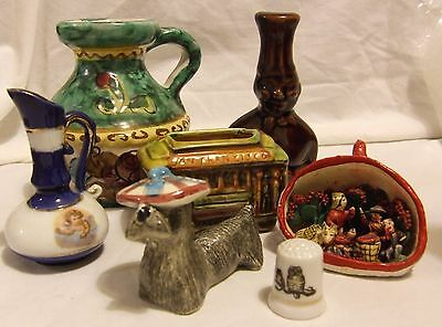 Collection of 7 colourful pottery ornaments