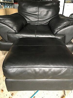 Black leather armchair with footstool