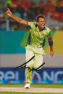 PAKISTAN: WAHAB RIAZ SIGNED 6x4 ODI ACTION PHOTO+COA