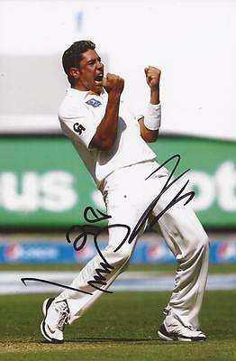 PAKISTAN: IMRAN KHAN SIGNED 6x4 TEST ACTION PHOTO+COA