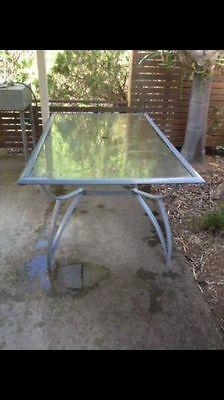 Outdoor glass table - seats 6 chairs / people