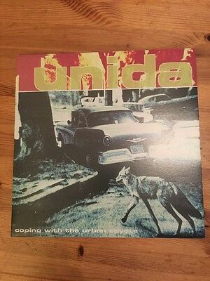Unida - Coping With The Urban Coyote - LP CAR03