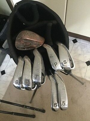 J Daly Golfing Items  4 Drivers  5,6,7,8,9,irons P Wedge S Wedge & Dunlop Iron W