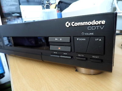 Commodore Amiga CDTV with keyboard, remote and games