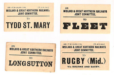 Four M&GN railway luggage labels