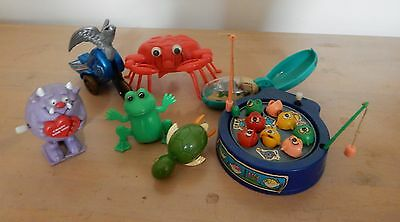 Vintage wind up/friction toys. Fishing game, motorbike,crab, Russ monster, frog.