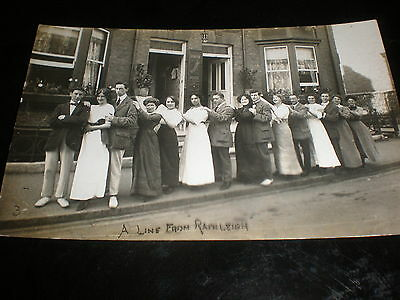 Old real photograph RPPC postcard group people in a line c1930s