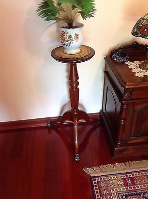Antique pedestal stand 77 cm tall with brass lions paw feet