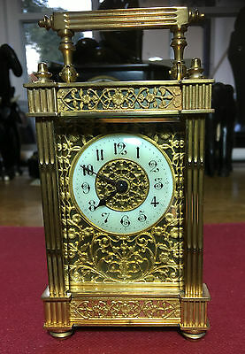 A Very Rare French Carriage Clock With Ormolu Filigree Panels To Front And Sides