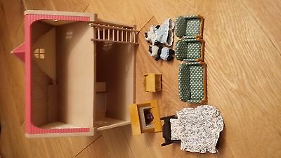 Sylvanian Families House with figures and furniture.