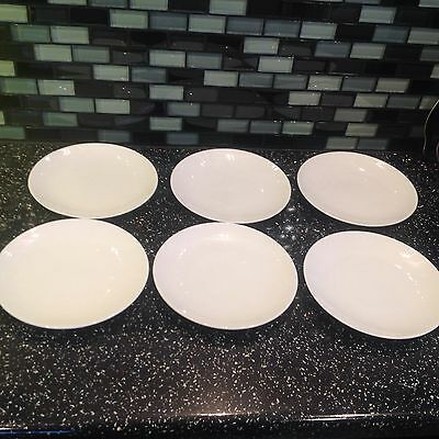 Six Susie Cooper Side Plates