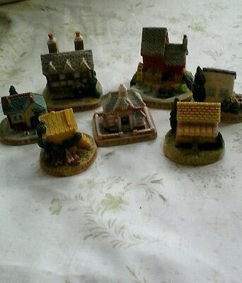 7 collectable  miniture houses by Tetley 1995