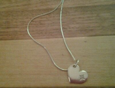 Sterling silver heart pendant with pink stone