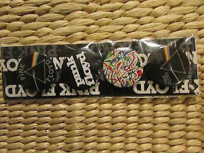 4 small Pink Floyd pins/buttons new