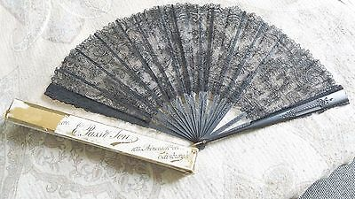 Vintage folding fan made of lace and black wood.