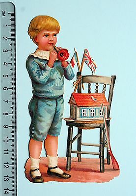 Large Victorian Embossed Scrap Boy With Toys Trumpet Flags Gun House 13 Cm Tall