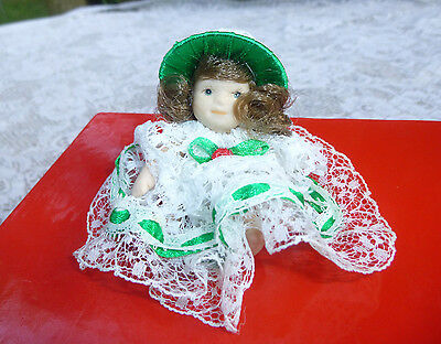 Small Porcelain Girl Doll 2 1/2in White Lace Dress and Hat Brown Hair Unbranded