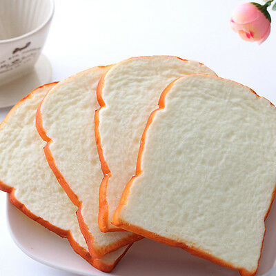 1PCS 14CM Jumbo Squishy Soft Scent sliced Bread Toast Kids Toy Hand Pillow SG