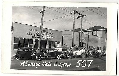 RPPC ARROW AMBULANCE and TOWING CADILLAC CAR TOW TRUCK EUGENE OREGON 1940s PHOT
