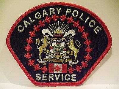 police patch  CALGARY POLICE SERVICE ALBERTA CANADA MYLAR WITH  FLAG