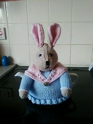Handknitted bunny rabbit with fluffy tail tea cosy