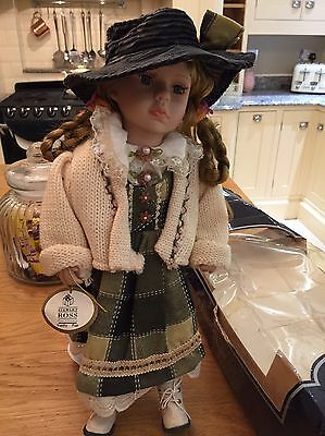 STEWART ROSS VANITY FAIR PORCELAIN DOLL NAMED R Donna WITH PIG TAILS