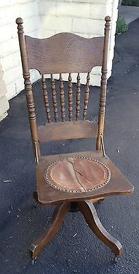 Antique Oak Wood Swivel Office Chair with Hand Carved Designs and Leather Seat