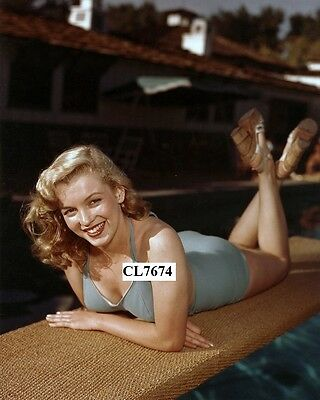 Marilyn Monroe Posing in a Bathing Suit on a Diving Board Photo