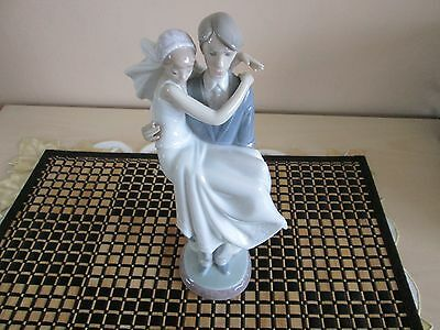 LLadro over the threshold bride & groom
