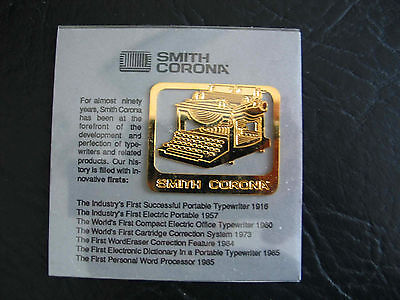 1985 Smith Corona Typewriter gold color charm in plastic sleeve