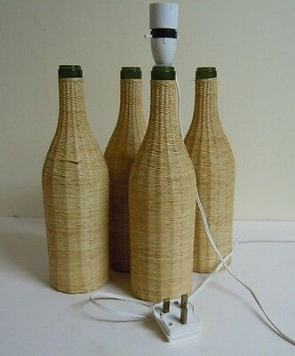 Four 1960/70s woven wicker covered wine bottles for table lamp base