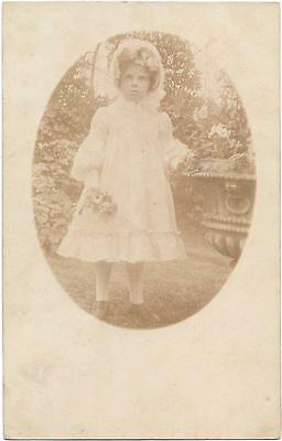 Photo Of  A   Young   Girl Taken   Outside  In   A    Garden.