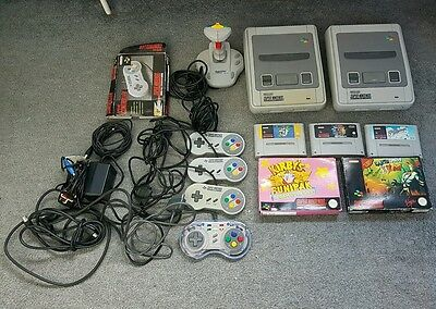 super nintendo consoles x2, 5 games and 5 controllers