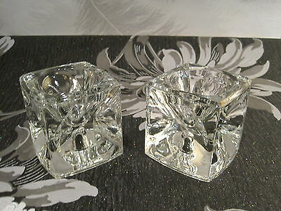 A lovely pair of double ended ice cube glass candle holders very pretty
