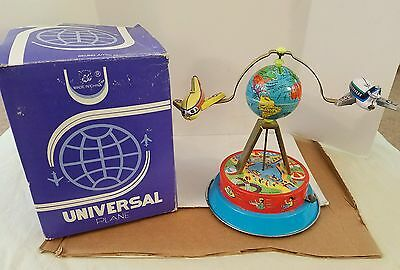 Universal Plane Tin Airplanes & Globe Collectors Wind Up Toy w/original box