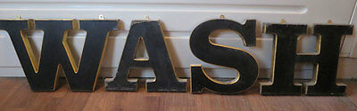 Giant vintage shop letters spelling WASH