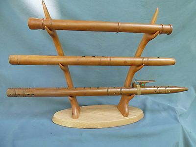 "Solid Cherry and Oak  ""antler"" stand holds three Native American flutes"