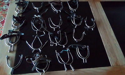 Large collection of riding spurs.