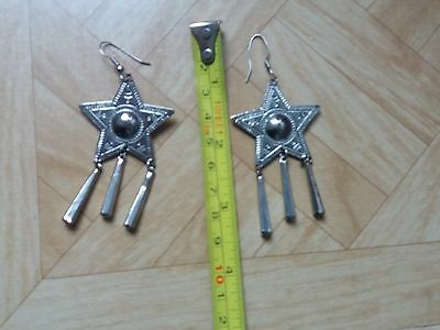 silver colour star shaped earrings with drops