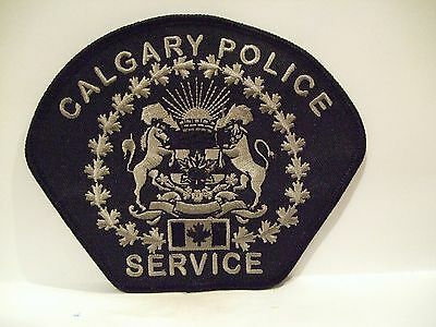 "police patch CALGARY POLICE SERVICE ALBERTA CANADA SUBDUED  BLACK  4"" PATCH"