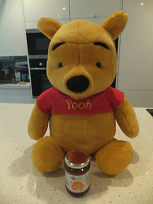 Large talking Winnie the pooh bear soft toy.