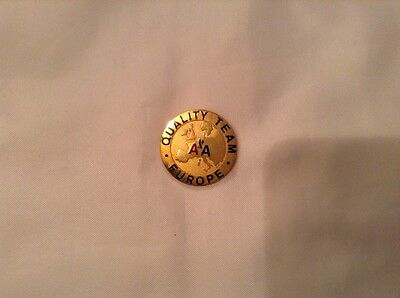 vintage american airlines badge gold colour 'quality team europe' vgc unused